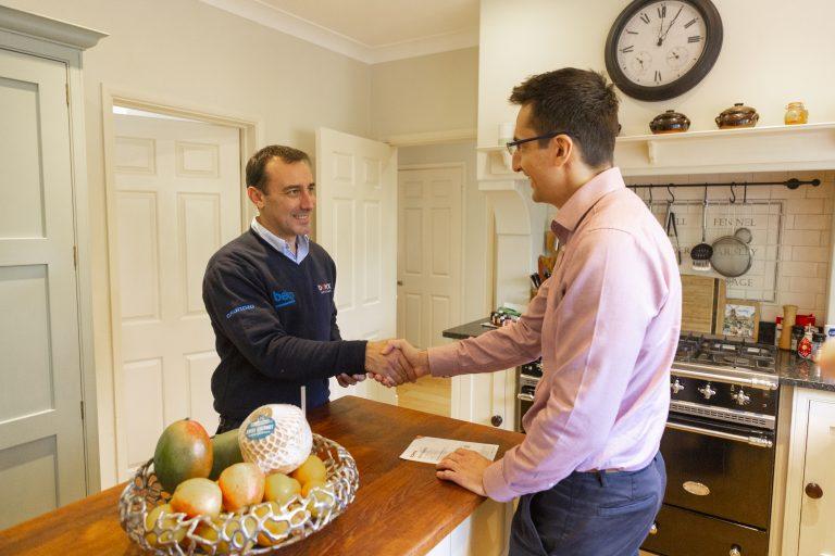 Domex engineer greeting customer