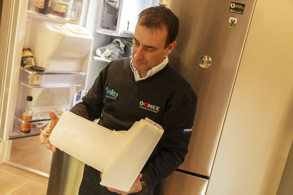 Domex engineer repairing fridge icemaker in Canary Wharf