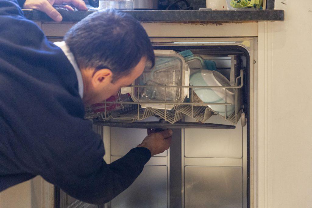 Domex Engineer repairing dishwasher in Watford