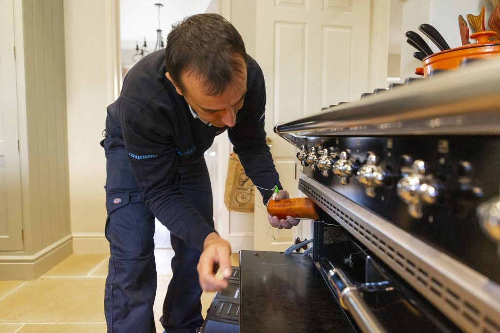 Domex engineer testing gas cooker in Dulwich